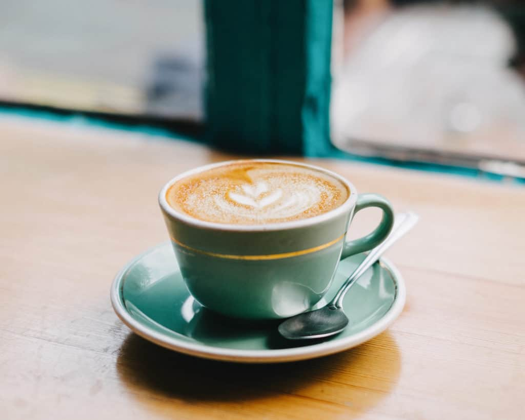 warm cup of coffee or tea ways to live simple lifestyle