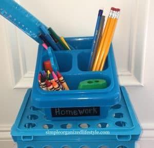 Homework supplies in a plastic bin