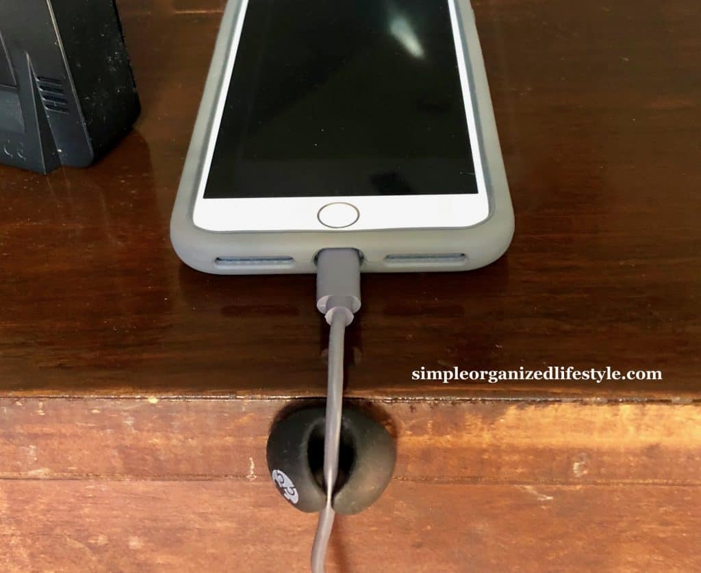Cable management clip for phone charger