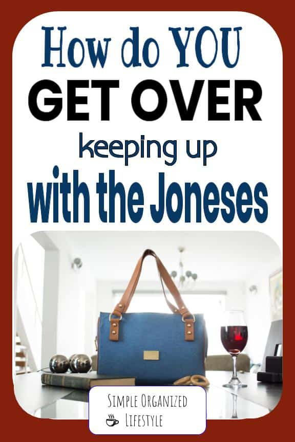 """Purse, wine and book on table with text overlay that reads """"How do you get over keeping up with the Joneses"""""""