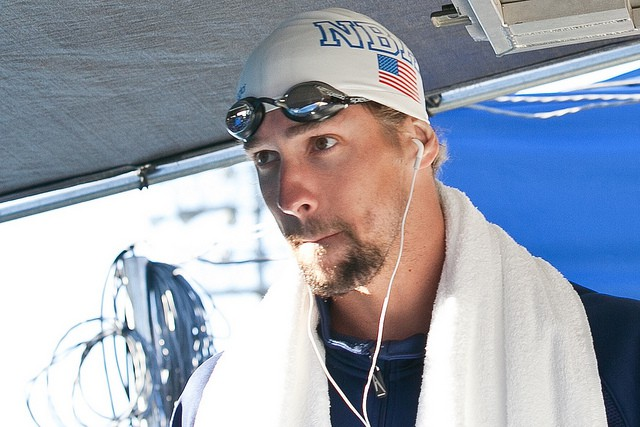 Swimmer listens to music before competition