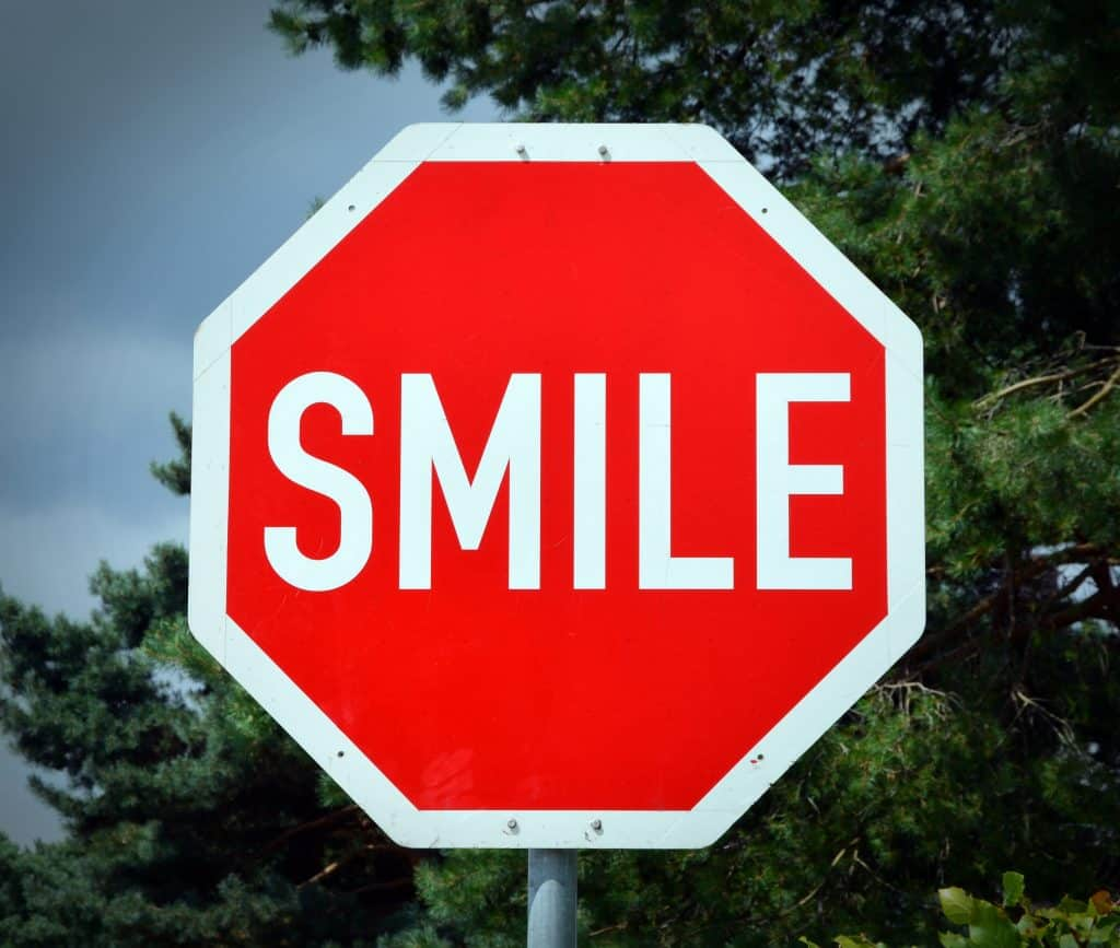 sign that says smile
